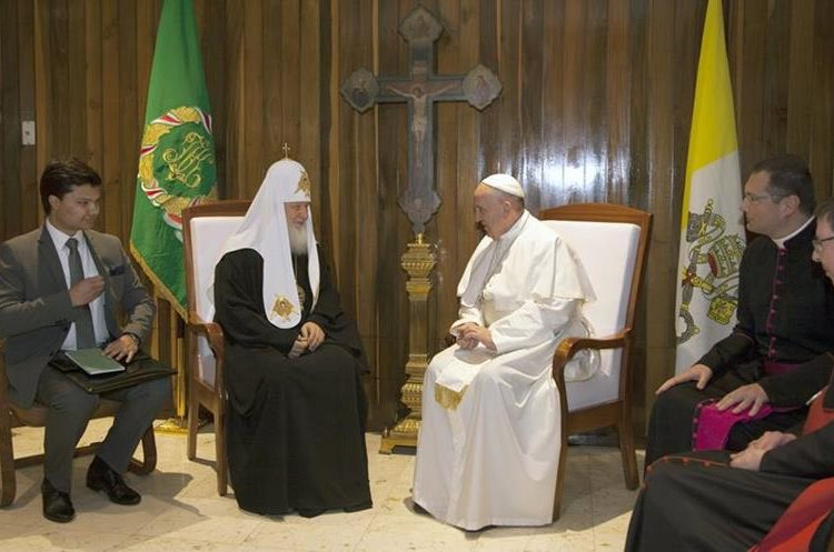 Pope Francis, center right,  and the head of the Russian Orthodox Church Patriarch  Kirill, center left,  meet at the Jose Marti aiport in Havana, Cuba, Friday, Feb. 12, 2016. This is the first-ever papal meeting with the head of the Russian Orthodox Church, a historic development in the 1,000-year schism within Christianity. (Ismael Francisco/Cubadebate via AP)
