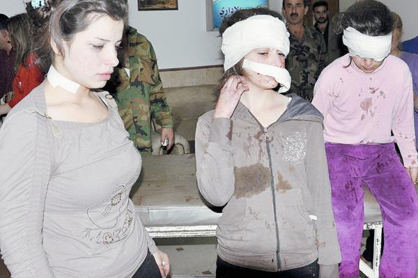 Tres menores  heridas en un atentado suicida perpetrado con un carrobomba  en la ciudad de Homs. (Foto Prensa Libre:EFE).