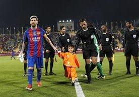 El pequeñoMurtaza Ahmadi compartió con Messi en Doha.