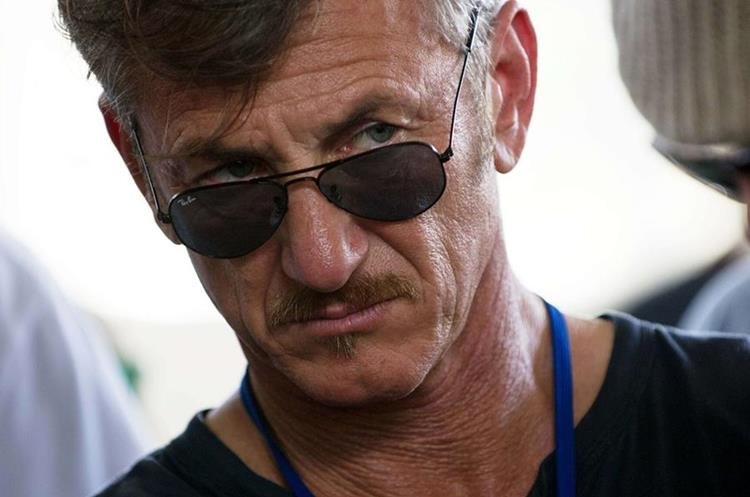 "(FILES) In this February 23, 2015 file photo, US actor Sean Penn tours the Lime Nursery and Grafting Project in Mirebalais, in the central plateau of Haiti. In a cloak-and-dagger plot fit for a Hollywood movie, US actor Sean Penn met secretly in the Mexican jungle in October with Joaquin ""El Chapo"" Guzman, conducting an explosive interview released a day after the drug kingpin"