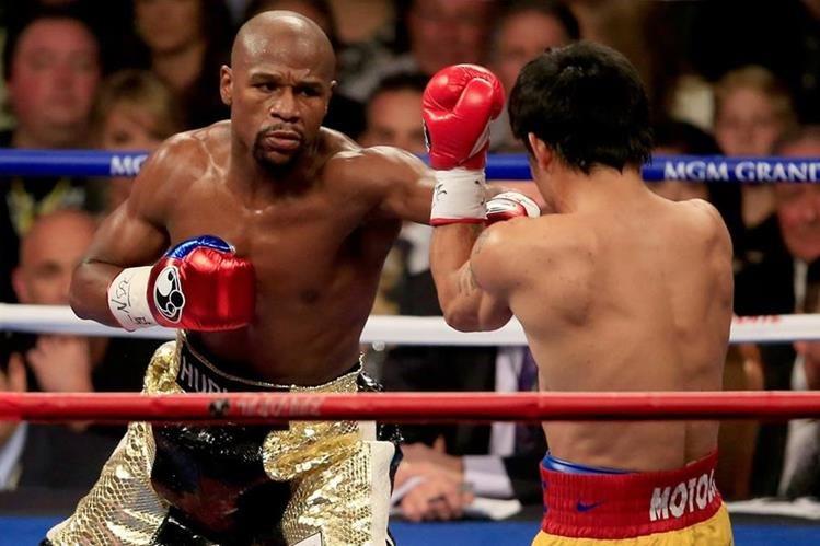 El combate entre el boxeador invicto y el campeón irlandés de las artes marciales mixtas podrá verse mediante televisión de alta definición. (Foto Prensa Libre: AFP)