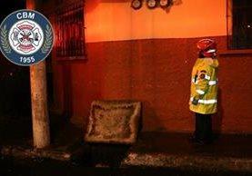 Bomberos Municipales encuentran cadáver dentro de una alcantarilla en el Barrio San Antonio, zona 6. (Foto Prensa Libre: CBM)