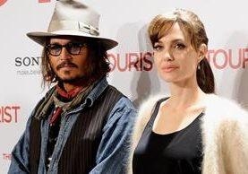 Johnny Depp y Angelina Jolie coincidieron en el rodaje de la película El Turista. (Foto Prensa Libre: gofugyourself.com)