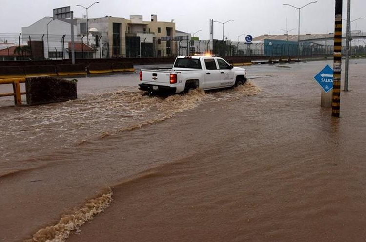 A truck drives along a flooded street in Manzanillo, Colima state, Mexico on October 23, 2015, during hurricane Patricia. The strongest hurricane ever recorded crashed into Mexico