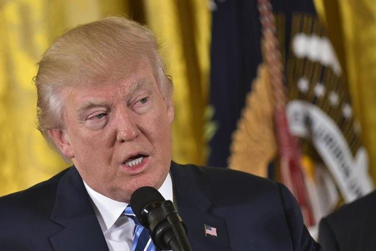 Donald Trump, presidente de EE. UU., durante una actividad en la Casa Blanca, el domingo. (Foto Prensa Libre: AFP).