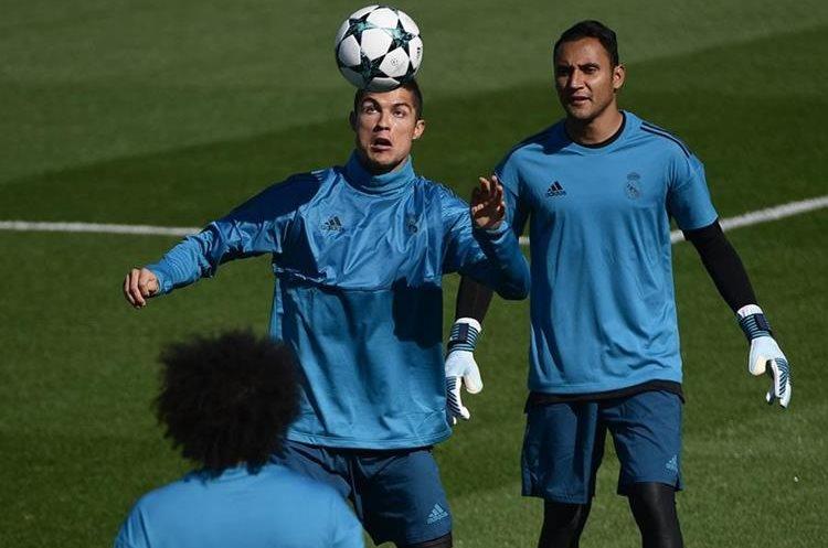 El delantero del Real Madrid, Cristiano Ronaldo se alista para jugar la Liga de Campeones. (Foto Prensa Libre: AFP)