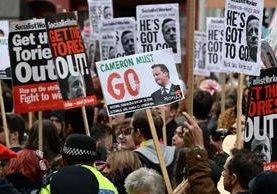 <span>Manifestantes</span> <span>piden </span><span>la dimisión de </span><span>David</span> <span>Cameron.(EFE)</span>