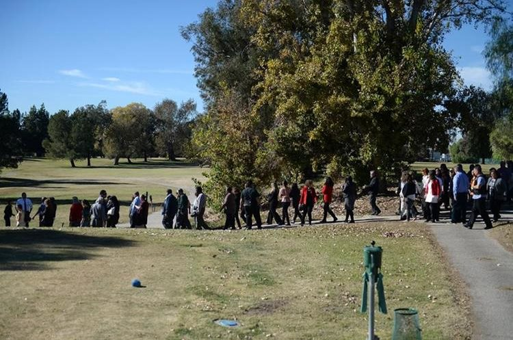 People gather at San Bernardino Golf Course after being evacuated near the scene of a shooting in San Bernardino, Calif. on Wednesday, Dec. 2, 2015. Police responded to reports of an active shooter at a social services facility.   (Micah Escamilla/Los Angeles News Group via AP)