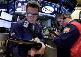La alianza de las empresas despertó las expectativas en la bolsa de valores. (Foto Prensa Libre: AP)