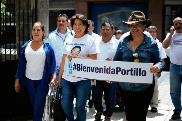 Integrantes del Frente Portillista se reunieron ayer en diferentes partes del país para manifestar su felicidad por el regreso del expresidente Alfonso Portillo a Guatemala, luego de cumplir una condena de prisión en Estados Unidos   (Foto Prensa Libre: AFP)