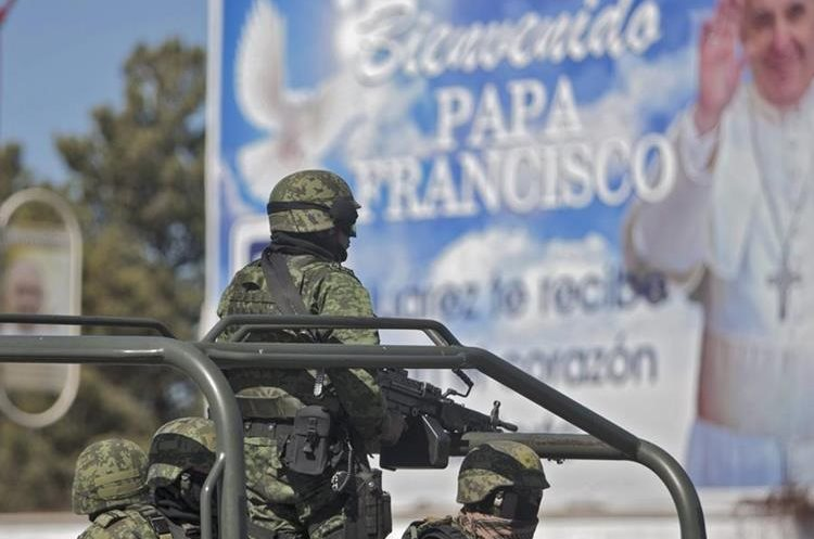 Mexican soldiers patrol the streets of Ciudad Juarez, Mexico on February 15, 2016. Pope Francis reached out to Mexico