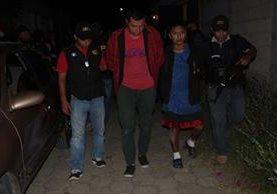 Dos hombres capturados por la muerte de una mujer el 16 de agosto último. (Foto Prensa Libre: PNC)