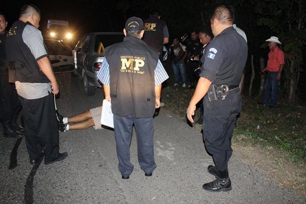 """<p>El cadáver apareció en el baúl de un vehículo que no era propiedad del occiso. (Foto Prensa Libre: Julio Vargas)<br _mce_bogus=""""1""""></p>"""