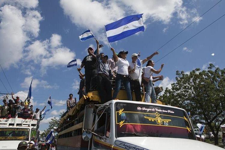 Campesinos marchan este martes en Managua. (Foto Prensa Libre: EFE).