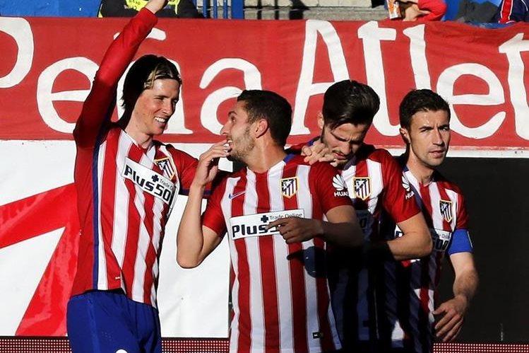 El Atlético doblegó al Granada y alcanzó al Barcelona con 76 puntos. (Foto Prensa Libre: EFE).