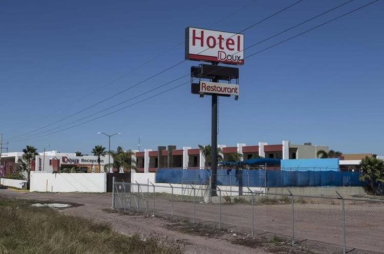 "This photo shows a view of the roadside hotel Doux in Los Mochis, Saturday, Jan. 9, 2016, where drug lord Joaquin ""El Chapo"" Guzman was taken by Mexican marines after his recapture Friday. Guzman was then flown in a navy helicopter to Mexico City and taken back to Antiplano, the same maximum-security prison he escaped in July. (AP Photo/Christian Palma)"