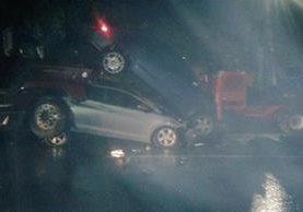 Accidente ocurrido en la bajada de Villalobos. (Foto Prensa Libre: PMT de Villa Nueva)