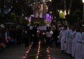 Desde las 5 horas, la procesión de Cristo Resucitado recorrió las principales calles de Huehuetenango. (Foto Prensa Libre: Mike Castillo)