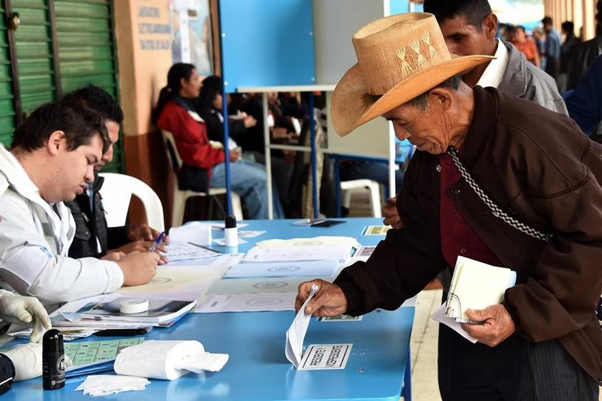 A man casts his vote at a polling station in San Juan Sacatepequez, 40 km west of Guatemala City, during general elections on September 6, 2015. Guatemalans streamed to the polls on Sunday in general elections held amid public disenchantment with government just days after the country