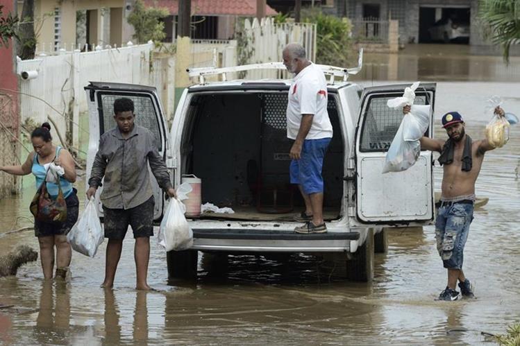 Varias inundaciones dejo el huracán María a su paso por Puerto Rico. (Foto Prensa Libre. AP)