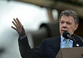 El presidente Juan Manuel Santos, durante una actividad pública. El mandatario firmó el decreto que legaliza la marihuana medicinal en Colombia. (Foto Prensa Libre: AFP).