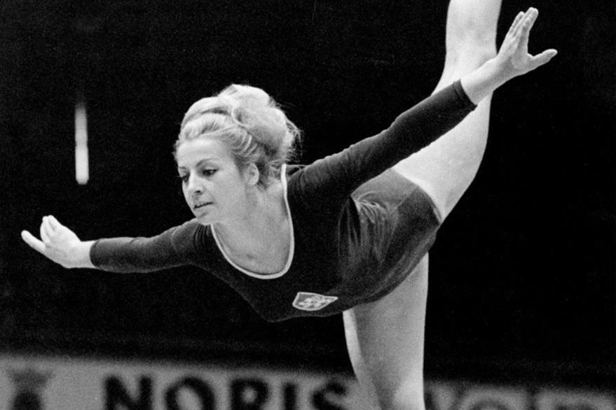 FILE - In this Sept. 1966, file photo, Vera Caslavska performs on the balance beam during the 16th Artistic Gymnastics World Championships in Dortmund, West Germany. Caslavska, multiple Olympic gold medalist in gymnastics and the most famous Czech sports woman of all times who stood up against the 1968 Soviet-led invasion of Czechoslovakia has died, in Prague, she was 74. (AP Photo, File)