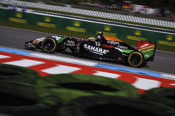<p>El piloto mexicano Sergio Pérez, de la escudería Force India, dijo sentirse feliz por el retorno de la Fórmula Uno a su país. (Foto Prensa Libre: EFE).<br></p>