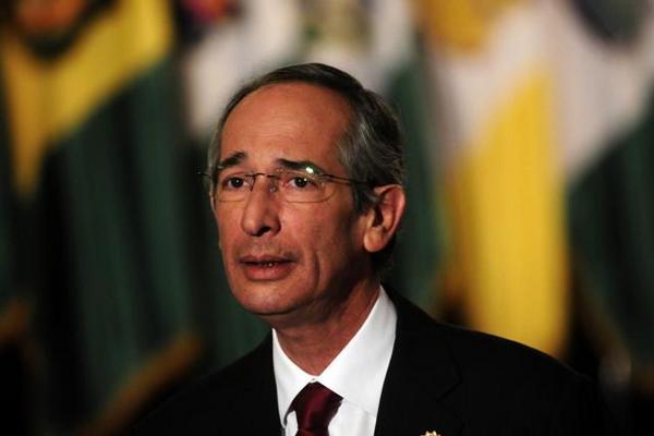 <p>Presidente Álvaro Colom, durante la presentación del informe. (Foto: EFE)<br></p>