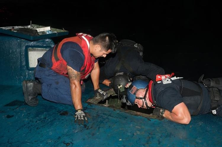 In this July 18, 2015 photo released by the U.S. Coast Guard, a Coast Guard Cutter Stratton boarding team investigates a self-propelled semi-submersible interdicted in international waters off the coast of Central America. The Stratton's crew recovered more than 6 tons of cocaine from the 40-foot vessel. The U.S. Coast Guard has seized 12,000 pounds (5,440 kilograms) of cocaine from a vessel in the Eastern Pacific in one of the largest busts of its kind. Cocaine seizures by the U.S. Coast Guard off Latin America have jumped to their highest levels in five years. Officials say Monday, Aug. 10, 2015, drug traffickers are increasingly turning to the sea to get their loads to U.S. markets.  (Petty Officer 2nd Class LaNola Stone/U.S. Coast Guard via AP)