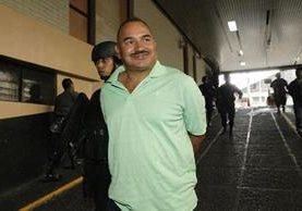Marco Baudilio Godoy Trujillo es ingresado a la Torre de Tribunales, en la capital. (Foto Prensa Libre: Hemeroteca PL).
