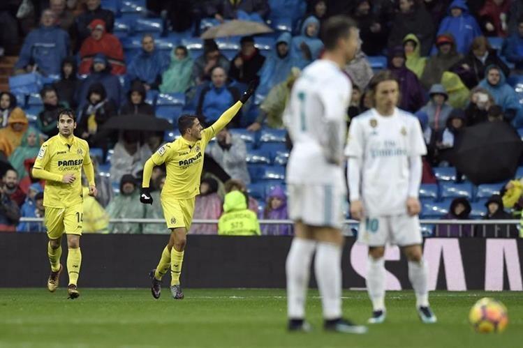 Pablo Fornals festeja luego de marcar el gol que dio el triunfo al Real Madrid, ante la frustración de Cristiano y Modric. (Foto Prensa Libre: AFP)