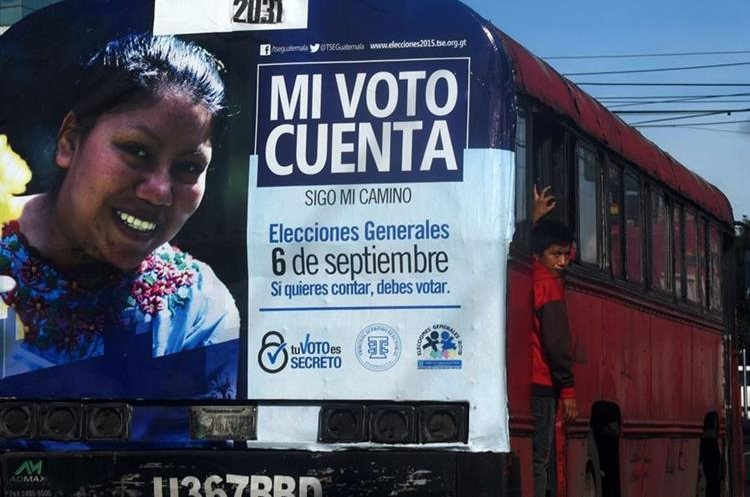 A bus displays an advertisement of the Supreme Electoral Tribunal which invites the population to vote, in Guatemala City on September 5, 2015 on the eve of Guatemala